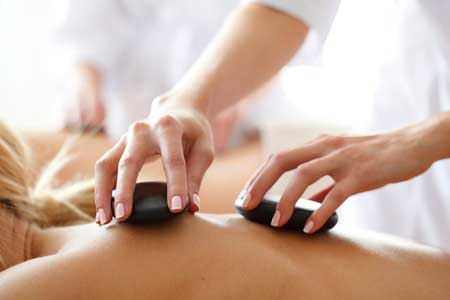 Learn hot stone therapy spa treatments